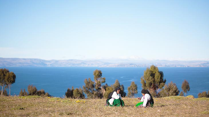 visit the amantani island in a trip from machu picchu to lake titicaca