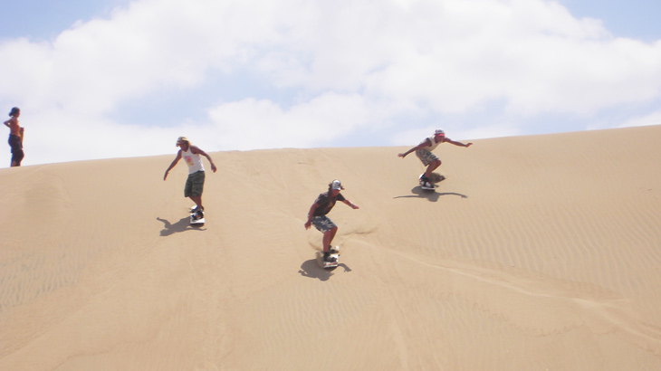 sandboarding peru tourist attraction