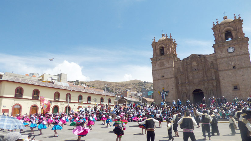 festival in the main square of puno, best time to visit peru