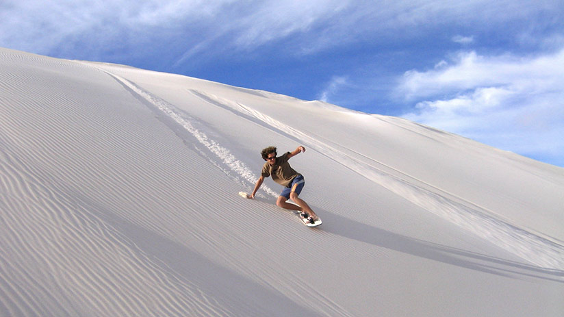 family vacation ideas sandboarding in huacachina