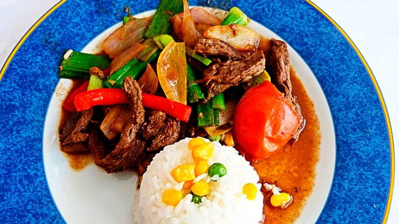 try the delicious lomo saltado in lima